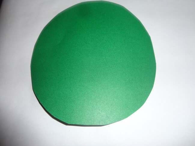Take a green colour Bristol board and cut circle. Christmas Decoration With Paper Crafting Ornaments (Tutorial)