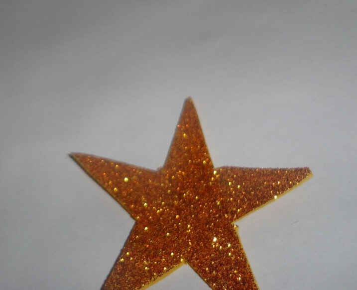 Take a glitter sheet and cut star using it. Christmas Decoration With Paper Crafting Ornaments (Tutorial)