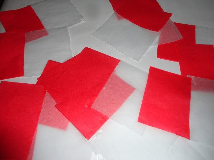 christmas-decorations Take red and white colour tissue papers and cut into pieces like this. Christmas Decoration With Paper Crafting Ornaments (Tutorial)