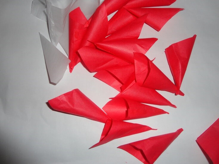 christmas-decorations Using these tissue papers make red and white cones like this.