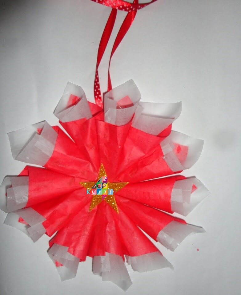 christmas-decorations Take a glitter sheet and cut a star from it. Paste the star middle of the design like this. Take a glitter sheet and cut a star from it. Paste the star middle of the design like this.