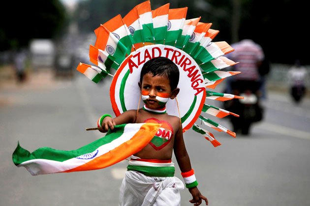 Indian-Kid-Selling-Flags-On-Independence-Day-Of-India The Ultimate List: 50+ Ideas for India Republic Day Celebration