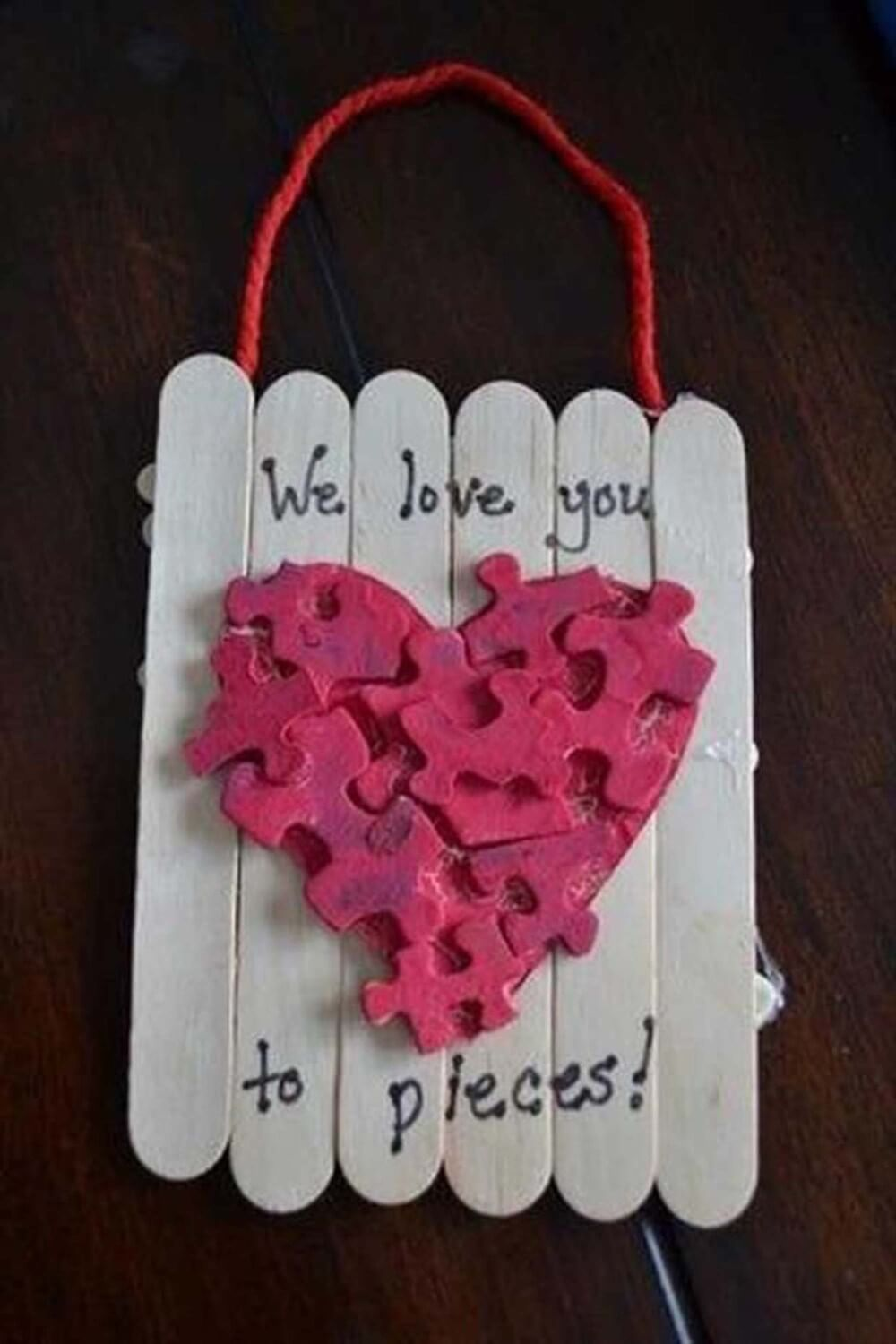 popsicle-stick-love-hanging 30+ Easy Valentine's Day Crafts for Kids