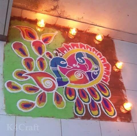 Diya lit Peacock Rangoli Design