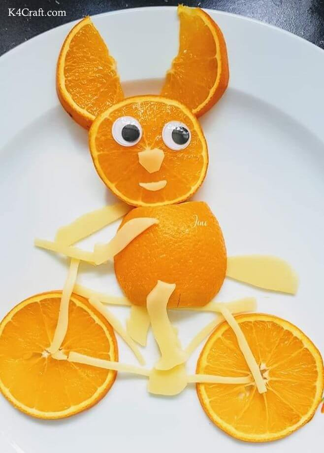 Mr. Orange On A Bicycle