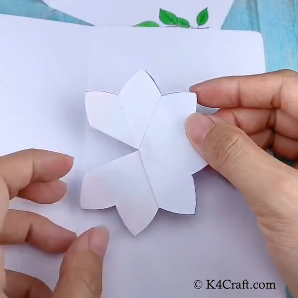 Placing the flowers ensemble inside the card